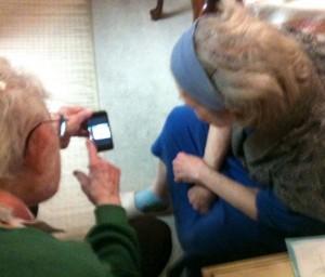 Granpa shows off ipod to Grandma.