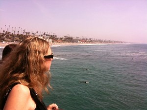 girl looking out to sea in oceanside