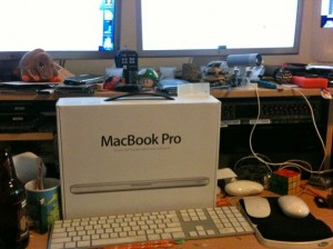 Shinny new toy on a cluttered desk!